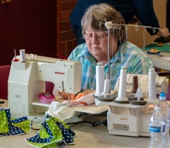 Nadeen at the serger with Swirl Skirt at 2016 Spring Fling