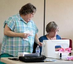 Nadeen teaching Swirl Skirt techniques to June at 2016 Spring Fling